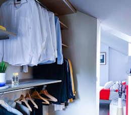 Organize suas roupas com um camarim: camarins de estilo escandinavo by TEKNIA ESTUDIO
